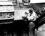 Painting_a_Maple_leaf_on_a_British_Great_War_Tank